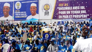Supporters of Chadian President Idriss Deby Itno gather for a rally in N'djamena, Chad, Friday April 9, 2021. Deby is seeking to extend his three-decade long rule, running for a sixth time in this oil-producing Central African nation that is home to nearly half a million refugees and also plays a prominent role in the fight against Islamic extremism in the Sahel. (AP Photo/Joel Kouam)