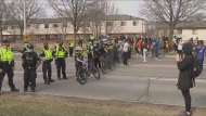 Peel police block protesters from marching to nearby train tracks.