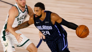 Orlando Magic's Khem Birch (24) drives against Milwaukee Bucks' Pat Connaughton (24) during Game 3 of an NBA basketball first-round playoff series, Saturday, Aug. 22, 2020, in Lake Buena Vista, Fla. (Mike Ehrmann/Pool Photo via AP)