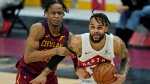 Toronto Raptors' Gary Trent Jr., right, drives to the basket against Cleveland Cavaliers' Isaac Okoro in the second half of an NBA basketball game, Saturday, April 10, 2021, in Cleveland. (AP Photo/Tony Dejak)