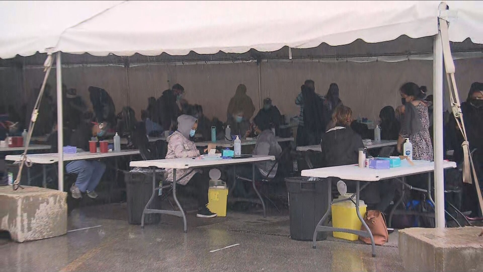 Residents are lining up once again this morning outside a Thorncliffe Park pop-up COVID-19 vaccination clinic.