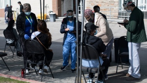 Staff from Michael Garron Hospital administer Moderna vaccine at a mobile vaccination site outside the Masjid Mosque in Toronto on Friday April 9, 2021. THE CANADIAN PRESS/Chris Young