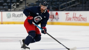 Columbus Blue Jackets' Nick Foligno runs a drill during NHL hockey practice, Tuesday, Jan. 5, 2021, in Columbus, Ohio. (AP Photo/Jay LaPrete)