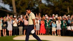 Hideki Matsuyama, of Japan, waves after winning the Masters golf tournament on Sunday, April 11, 2021, in Augusta, Ga. (AP Photo/Matt Slocum)