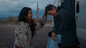 "FILE - In this file photo, Director Chloe Zhao, left, appears with actress Frances McDormand on the set of ""Nomadland."" ""Nomadland"" has won four prizes, including best picture, at the British Academy Film Awards on Sunday, April 11, 2021. The film's director, Chloe Zhao, became only the second woman to win the best director trophy, and star Frances McDormand was named best actress. ""Nomadland"" also took the cinematography prize on Sunday. (Searchlight Pictures via AP, FIle)"