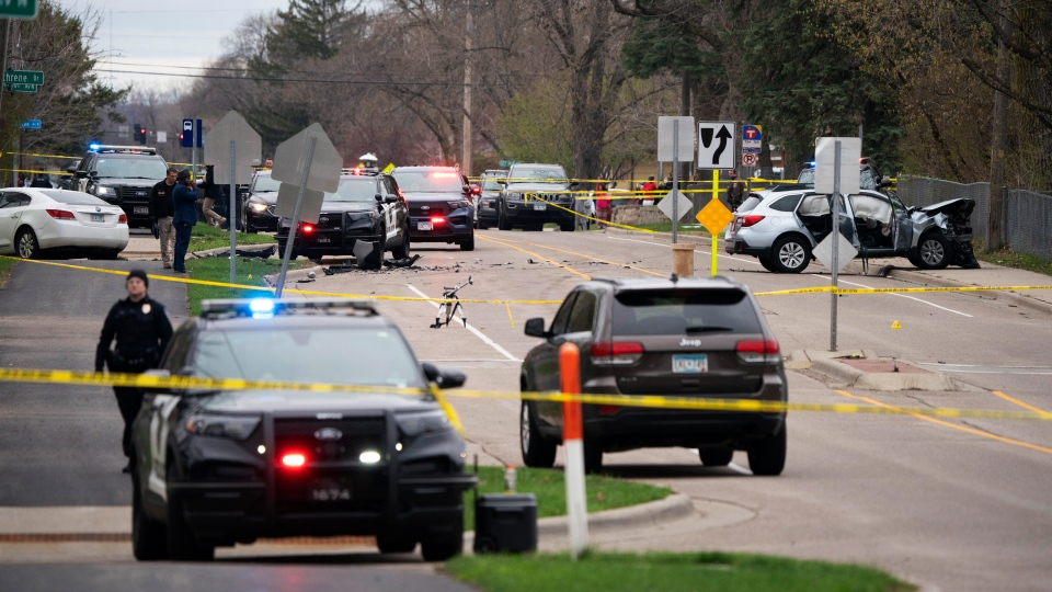Authorities work the scene at the site of a shooting involving a police officer, Sunday, April 11, 2021, in Brooklyn Center, Minn. (Jeff Wheeler/Star Tribune via AP)