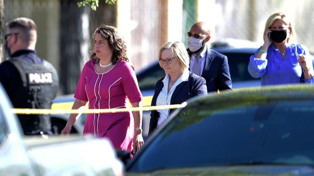 Knoxville Mayor Indya Kincannon, left, arrives at the scene of a shooting at Austin-East High School in Knoxville, Tenn. on Monday, April 12, 2021. (Calvin Mattheis/Knoxville News Sentinel via AP)
