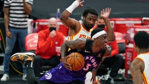 Toronto Raptors forward Pascal Siakam (43) drives around Atlanta Hawks forward Solomon Hill (18) during the second half of an NBA basketball game Tuesday, April 13, 2021, in Tampa, Fla. (AP Photo/Chris O'Meara)