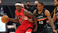Toronto Raptors forward Pascal Siakam (43) works in against San Antonio Spurs forward DeMar DeRozan (10) during the first half of an NBA basketball game Wednesday, April 14, 2021, in Tampa, Fla. (AP Photo/Chris O'Meara)
