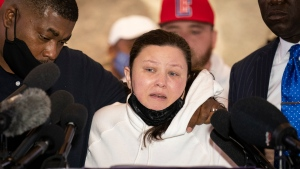 Katie Wright, mother of the Daunte Wright, speaks alongside her husband Aubrey, left and attorney Ben Crump, right, during a news conference at New Salem Missionary Baptist Church, Thursday, April 15, 2021, in Minneapolis. Former Brooklyn Center police Officer Kim Potter was charged Thursday with second-degree manslaughter in Sunday's shooting of Wright, a 20-year-old Black man, during a traffic stop. (AP Photo/John Minchillo)