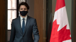 Prime Minister Justin Trudeau makes his way to a news conference in Ottawa, Friday April 16, 2021. THE CANADIAN PRESS/Adrian Wyld