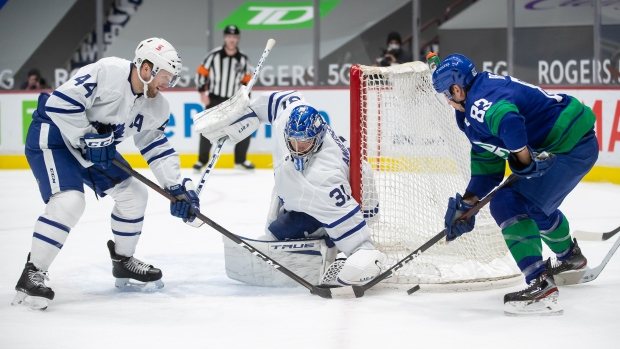 Toronto Maple Leafs goalie Frederik Andersen (31), of Denmark, stops Vancouver Canucks' Jay Beagle (83) as Toronto's Morgan Rielly (44) defends during the second period of an NHL hockey game in Vancouver, on Saturday, March 6, 2021. THE CANADIAN PRESS/Darryl Dyck
