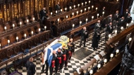 Pallbearers carry the coffin of the Duke of Edinburgh during his funeral, at St George's Chapel in Windsor Castle, Windsor, England, Saturday April 17, 2021. Prince Philip died April 9 at the age of 99 after 73 years of marriage to Britain's Queen Elizabeth II. (Dominic Lipinski/Pool via AP)