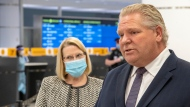 Ontario Premier Doug Ford and Solicitor General Sylvia Jones answer questions after touring the COVID-19 testing centre in Terminal 3 at Pearson Airport in Toronto on Wednesday, February 3, 2021. THE CANADIAN PRESS/Frank Gunn