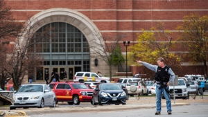 Law enforcement directs traffic away after a shooting at Westroads Mall on Saturday, April 17, 2021 in Omaha, Neb. Shots rang out Saturday in the mall, leaving one person critically wounded and sending shoppers running for the exit. (Chris Machian/Omaha World-Herald via AP)