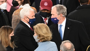 Vice President Mike Pence talks with Former President George W. Bush ahead of President-elect Joe Biden's inauguration ceremony, Wednesday, Jan. 20, 2021, in Washington.(Saul Loeb/Pool Photo via AP)
