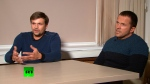FILE In this file photo taken on Thursday, Sept. 13, 2018, from video provided by the RT channel, Ruslan Boshirov, left, and Alexander Petrov attend their first public appearance in an interview with the Kremlin-funded RT channel in Moscow, Russia. The Czech Republic announced Saturday that it was expelling 18 Russian diplomats who it has identified as spies in a case related to a huge ammunition depot explosion in 2014. Czech police's organized crime unit on Saturday published photos of two foreign citizens who visited the country, including the Zlin region where Vrbetice is located, between Oct. 11 and Oct. 16 in 2014 and asked the public for any information about them. The two were using Russian passports and were identified as Alexander Petrov, 41, and Ruslan Boshirov, 43. Petrov and Boshirov were charged in absentia by Britain in 2018 for trying to kill former Russian spy Sergei Skripal and his daughter, Yulia, with the Soviet nerve agent Novichok. (RT channel video via AP)