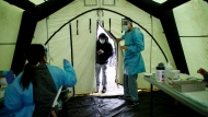 A man enters a tent at a pop-up vaccine clinic in Toronto's Jane and Finch neighbourhood, in the M3N postal code, on Saturday, April 17, 2021. Despite rates of COVID-19 deaths and hospitalizations far exceeding other areas of the city, residents of the M3N postal code continue to struggle with the lowest vaccination rates in Toronto. THE CANADIAN PRESS/Cole Burston