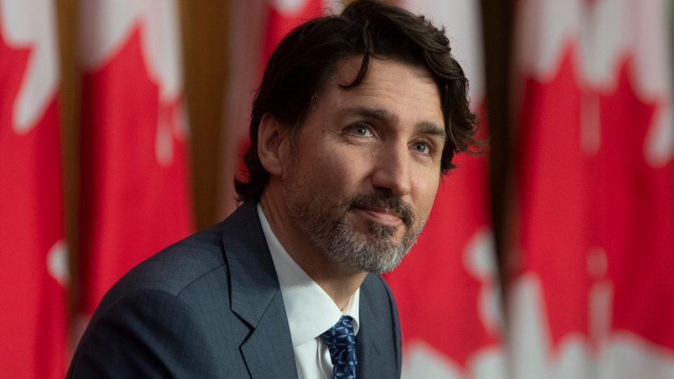 Prime Minister Justin Trudeau listens to a speaker during a news conference in Ottawa, Friday April 16, 2021. THE CANADIAN PRESS/Adrian Wyld