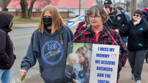 Family and friends of the victims of the April 2020 murder rampage in rural Nova Scotia, walk to the RCMP detachment as they mark the one-year anniversary in Bible Hill, N.S. on Sunday, April 18, 2021.THE CANADIAN PRESS/Andrew Vaughan