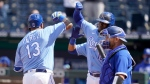 Kansas City Royals Salvador Perez, left, celebrates with teammate Jorge Soler, right, after hitting a two-run home run during the seventh inning of a baseball game against the Toronto Blue Jays at Kauffman Stadium in Kansas City, Mo., Sunday, April 18, 2021. (AP Photo/Orlin Wagner)