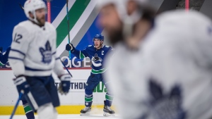 Vancouver Canucks' Bo Horvat celebrates his goal during the second period of an NHL hockey game against the Toronto Maple Leafs, in Vancouver, B.C., Sunday, April 18, 2021. THE CANADIAN PRESS/Darryl Dyck