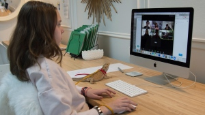 A grade 6 student takes part in a virtual school session with her teacher and classmates via Zoom from her home in North Vancouver B.C. Thursday, April 2, 2020.  As a part of maintain physical distancing during the COVID-19 pandemic students are not allowed to return to school for the time being and are learning from home.  THE CANADIAN PRESS/Jonathan Hayward
