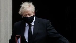 Britain's Prime Minister Boris Johnson leaves 10 Downing Street to attend the weekly session of Prime Ministers Questions in Parliament in London, Wednesday, April 14, 2021. (AP Photo/Kirsty Wigglesworth)