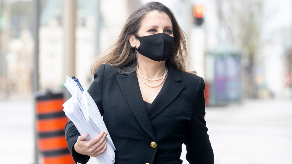 Minister of Finance Chrystia Freeland walks to a news conference before delivering the federal budget in Ottawa, Monday April 19, 2021. THE CANADIAN PRESS/Adrian Wyld