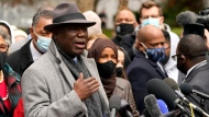 Ben Crump, left, the attorney representing George Floyd's family, speaks during a news conference outside of the Hennepin County Government Center in Minneapolis on Monday, April 19, 2021, before the murder trial against former Minneapolis police officer Derek Chauvin advances to jury deliberations. (AP Photo/Julio Cortez)