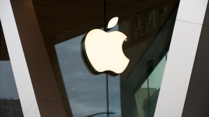 This Saturday, March 14, 2020 file photo shows an Apple logo on the facade of the downtown Brooklyn Apple store in New York. (AP Photo/Kathy Willens, File)