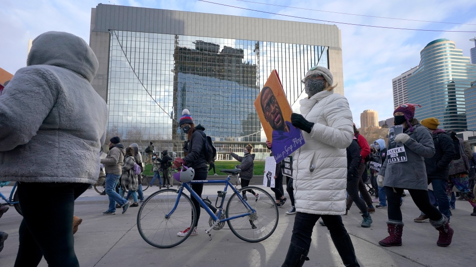 People participate in a rally in Minneapolis on Monday, April 19, 2021, after the murder trial against former Minneapolis police officer Derek Chauvin advanced to jury deliberations. (AP Photo/Julio Cortez)