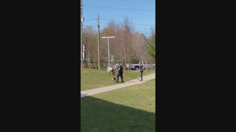This image taken from a social media video shows an OPP officer involved in some sort of physical altercation with a child in Gravenhurst over the weekend.Peel police have been asked to investigate the incident.