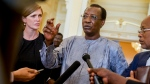 In this Wednesday, April 20, 2016 file photo, Chadian President Idriss Deby Itno, center, answers questions from members of the media as U.S. Ambassador to the United Nations Samantha Power, left, listens at the presidential palace in N'Djamena, Chad. Deby, who ruled the central African nation for more than three decades, was killed on the battlefield Tuesday, April 20, 2021 in a fight against rebels, the military announced on national television and radio. (AP Photo/Andrew Harnik, File)