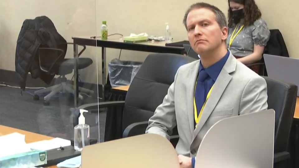In this image from video, former Minneapolis police Officer Derek Chauvin listens as his defense attorney Eric Nelson gives closing arguments as Hennepin County Judge Peter Cahill preside Monday, A...