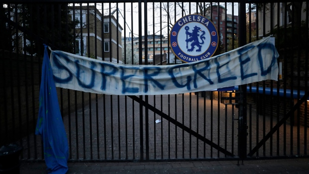 A banner hangs from one of the gates of Stamford Bridge stadium in London where Chelsea fans were protesting against Chelsea's decision to be included amongst the clubs attempting to form a new European Super League, Tuesday, April 20, 2021. Reaction to the proposals from 12 clubs to rip up European soccer by forming a breakaway Super League has ranged from anger and condemnation to humor and sarcasm. (AP Photo/Matt Dunham)