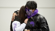 During the fifth anniversary observance of Prince's death, Patrice Files, of Detroit, right, consoles friend Virginia Ann Rausch, of Blaine, Minn., at Paisley Park, Wednesday, April 21, 2021, in Chanhassen, Minn. Fans of the legendary musician and artist were invited, 20 at a time, to pay their respects. (AP Photo/Stacy Bengs)