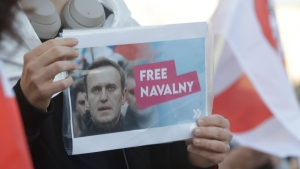 Supporters of imprisoned Russian opposition leader Alexei Navalny stage a protest before the Russian Embassy in Warsaw, Poland, on Wednesday, April 21, 2021, calling for his release in an action timed with massive rallies in Russia for Navalny, whose health is reportedly declining rapidly while on a hunger strike.(AP Photo/Czarek Sokolowski)