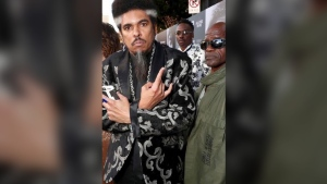 "In this photo provided by Nzazi Malonga, Shock G, left, poses at the ""All Eyez On Me"" film premiere in Los Angeles on June 14, 2017. Shock G, who blended whimsical wordplay with reverence for '70s funk as leader of the off-kilter hip-hop group Digital Underground, has died. He was 57. Nzazi Malonga, a longtime friend who served as head of security and helped manage the group, said the rapper-producer was found unresponsive Thursday, April 22, 2021, in a hotel room in Tampa, Fla. (Nzazi Malonga via AP)"