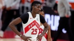Toronto Raptors forward Chris Boucher walks off the court during the second half of an NBA basketball game against the Detroit Pistons, Wednesday, March 17, 2021, in Detroit. (AP Photo/Carlos Osorio)