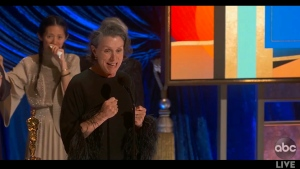 """In this video image provided by ABC, Frances McDormand accepts the best picture award for """"Nomadland"""" as director Chloe Zhao looks on at the Oscars on Sunday, April 25, 2021. (ABC via AP)"""