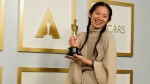 "Director/Producer Chloe Zhao, winner of the award for best picture for ""Nomadland,"" poses in the press room at the Oscars on Sunday, April 25, 2021, at Union Station in Los Angeles. (AP Photo/Chris Pizzello, Pool)"