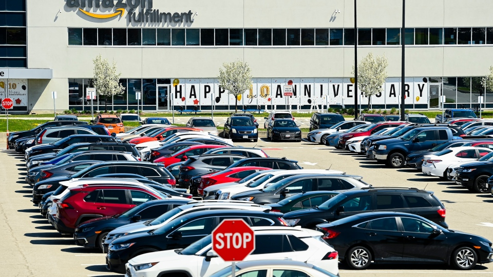 A full parking lot at one of the Amazon Fulfillment Centres during the during the COVID-19 pandemic in Mississauga, Ont., on Monday, April 26, 2021. Peel and Toronto have closed businesses with five or more COVID-19 cases linked to the workplace under new guidelines to help curb the spread. THE CANADIAN PRESS/Nathan Denette