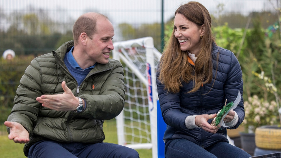 Britain's Prince William and Kate, Duchess of Cambridge visit the Cheesy Waffles Project in Durham, England, Tuesday April 27, 2021. The charity for children, young people and adults with additional needs across County Durham, is one of the charitable organisations that benefitted from donations given around the time of the royal couple's wedding. (Andy Commins/Pool via AP)