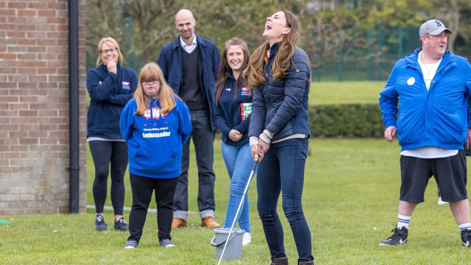 Britain's Kate, Duchess of Cambridge swings a golf club during a visit with Prince William to the Cheesy Waffles Project in Durham, England, Tuesday April 27, 2021. The charity for children, young people and adults with additional needs across County Durham, is one of the charitable organisations that benefitted from donations given around the time of the royal couple's wedding. (Andy Commins/Pool via AP)