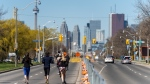 A group of runners run along Lake Shore Blvd. East as road closures come into effect for the return of the ActiveTO program in Toronto on Saturday, May 1, 2021.THE CANADIAN PRESS/Yader Guzman