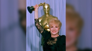 """FILE - In this April 11, 1988 file photo, Olympia Dukakis holds her Oscar at the Shrine Auditorium in Los Angles after being honored at the 60th Academy Awards as best supporting actress for her role in """"Moonstrck."""" Olympia Dukakis, the veteran stage and screen actress whose flair for maternal roles helped her win an Oscar as Cher's mother in the romantic comedy """"Moonstruck,"""" has died. She was 89. (AP Photo/Lennox Mcleondon, File)"""