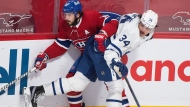 Montreal Canadiens' Phillip Danault (24) gets tangled up with Toronto Maple Leafs' Auston Matthews during first period NHL hockey action in Montreal, Monday, May 3, 2021.THE CANADIAN PRESS/Graham Hughes