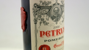 A bottle of Petrus red wine that spent a year orbiting the world in the International Space Station is pictured in Paris Monday, May 3, 2021. The bottle will be auctioned at Christie's auction house. (AP Photo/Christophe Ena)