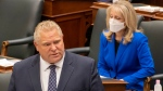 Ontario Long Term Care Minister Merrilee Fullerton listens as Premier Doug Ford answers questions calling for her dismissal at Queen's Park in Toronto on Wednesday, May 5, 2021. The premier has just finished a quarantine due to a COVID-19 exposure. THE CANADIAN PRESS/Frank Gunn